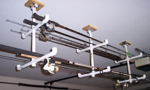 Homemade garage fishing rod holders