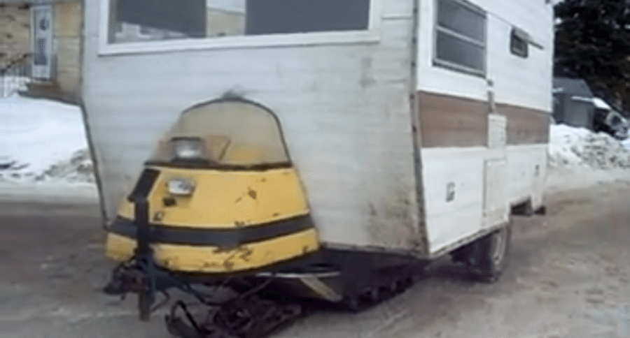 only in canada snowmobile powered ice fishing camper