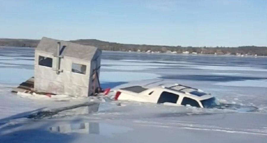 Cadillac escalade and ice fishing shack sink into the deep for Snow bear ice fishing