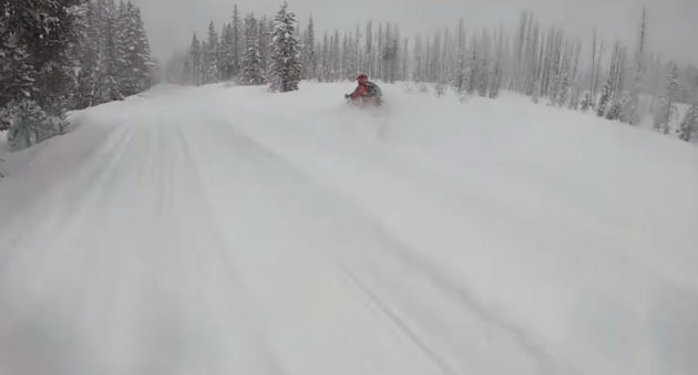 snowmobile buried in snow